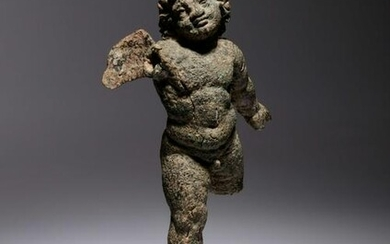 A Roman Bronze Figure of Eros Height 6 1/2 inches.