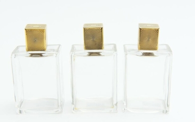 A SET OF THREE ART DECO GILT METAL TOPPED PERFUME COLOGNE BOTTLES, 10 CM HIGH, LEONARD JOEL LOCAL DELIVERY SIZE: SMALL