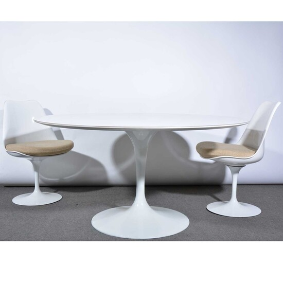 A 'Tulip' dining table and eight chairs, designed by Eero Saarinen