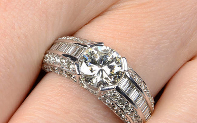 A brilliant and baguette-cut diamond dress ring.