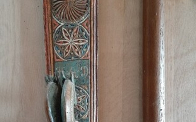 A carved mangleboard with horse handle and a roler. 19th century. L. 90 cm. (2)