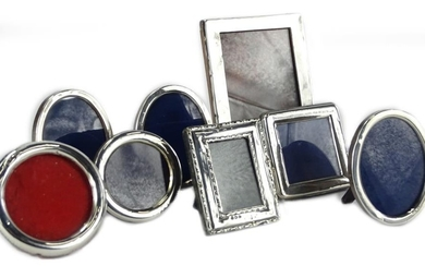 A collection of various silver mounted small photograph fram...
