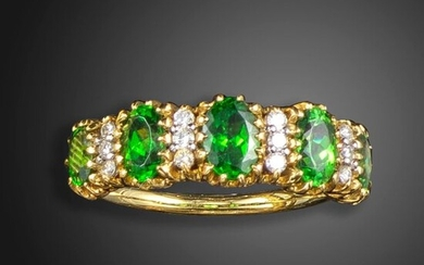A demantoid garnet and diamond five-stone ring, the five graduated oval-shaped garnets are separated with diamonds in yellow gold, size O ½