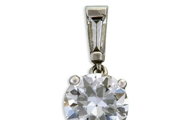 A diamond and white gold pendant