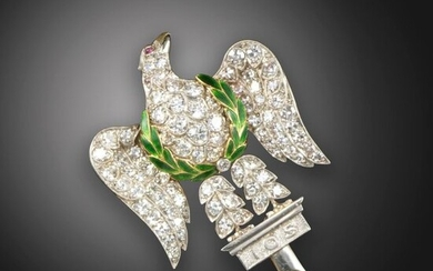 A diamond-set Regimental brooch for the Royal Scots Greys, the eagle set with circular-cur diamonds, with ruby eyes and green enamel decoration to the laurels in platinum on gold, 3.5cm high