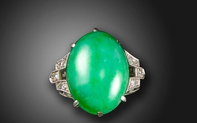 A jade and diamond ring, the green jadeite jade cabochon is set with single-cut diamonds to the shoulders in white gold, size P 1/2