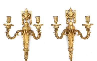 A pair French Louis XVI style gilt bronze wall lights each with twin-arms. 19th century....