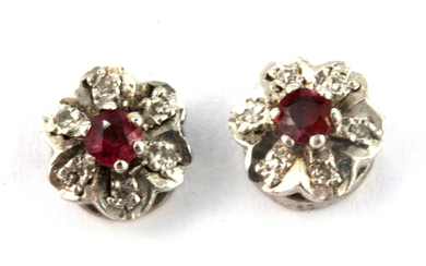 A pair of 9ct yellow gold ruby and diamond set cluster earrings, Dia. 0.58cm.