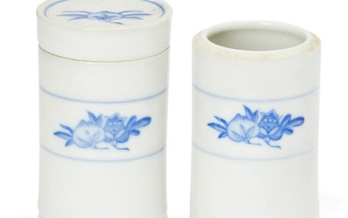 A pair of Chinese porcelain cylindrical boxes,...