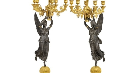 A pair of Empire style gilt and patinated bronze candelabra after model by Pierre-Philippe Thomire. France, 20th century. H. 103 cm. (2)