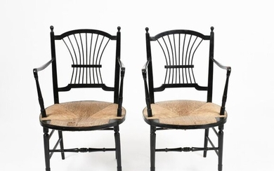 A pair of Morris & Co ebonised wood Rossetti chairs possibly designed by Dante Gabriel Rossetti, turned legs with dowel lyre back, with rush seat, 89cm high (2) Literature Linda Parry William Morris, V&A Exhibition catalogue, 1996, page 176 cat...