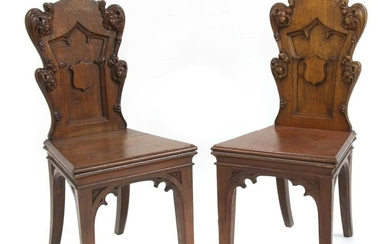A pair of Victorian oak Gothic hall chairs