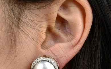 A pair of mabe pearl and diamond cluster earrings.