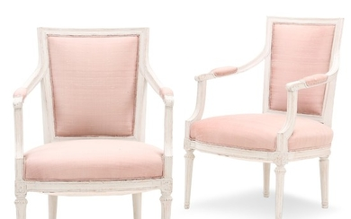 A pair of painted late Gustavian armchairs. Sweden, early 19th century. (2).
