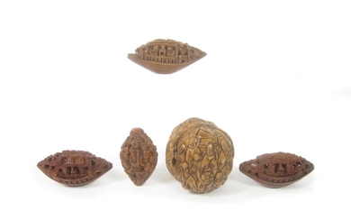 A small collection of carved peach stones and walnut shells