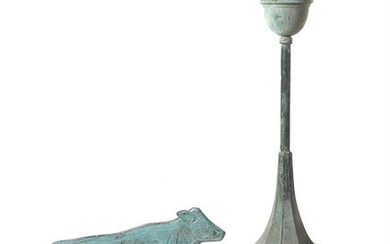 A verdigris copper weathervane modelled as a cow