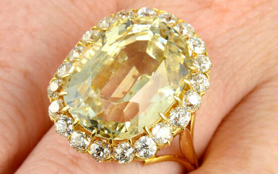 A yellow sapphire and old-cut diamond cluster ring.