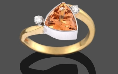 An 18 Carat Gold Topaz and Diamond Three Stone Ring,...