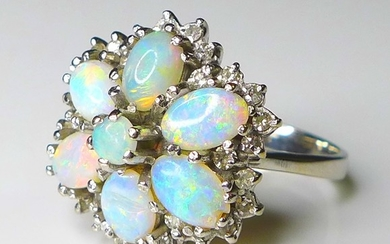 An 18ct white gold and opal dress ring, of flower head form,...