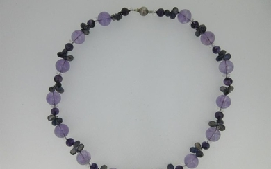 An amethyst and iolite bead necklace,