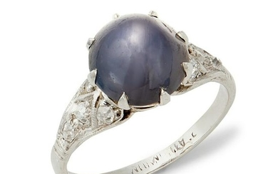 An early 20th century star sapphire and diamond ring.