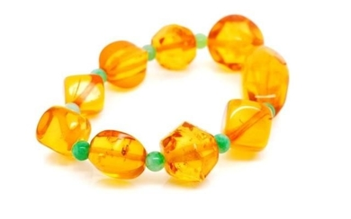 Baltic honey amber beaded bracelet with green jadeite beads....