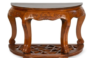 """CHINESE CARVED WOODEN DEMILUNE CONSOLE TABLE Shaped apron with raised foliate carving. Openwork lattice stretcher. Height 33"""". Width..."""