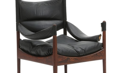 """Kristian S. Vedel: """"Modus"""". An easy chair with rosewood frame. Loose cushions upholstered with patinated black leather."""