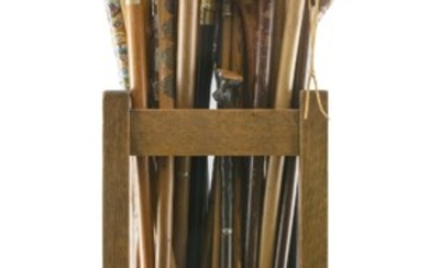 MISSION OAK STAND CONTAINING APPROX. SIXTY-FIVE ASSORTED CANES Stand stamped 432511 on underside. Canes include a Dartmouth College...