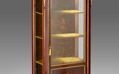 Mahogany veneer display case opening to a partially glazed leaf and decorated with brass filet marquetry. Sides with a glass bottom. Red Breche marble top.