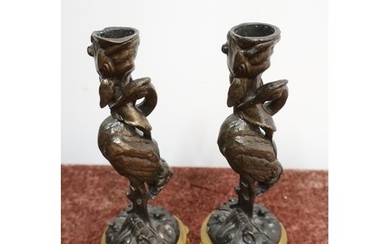 Pair of bronze candlesticks in the form of storks, with gild...