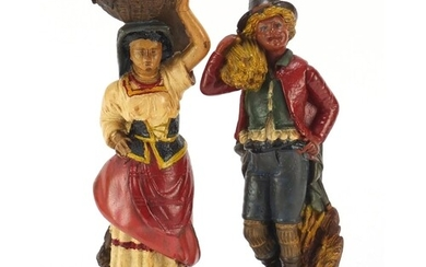 Pair of hand painted plaster figures of farmers, the largest...