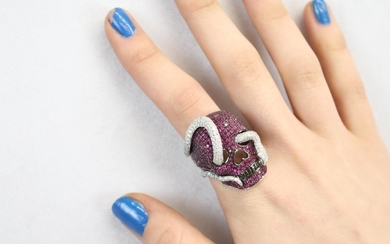 Skull ring with rubies and diamonds comprising 150 cut rubie...