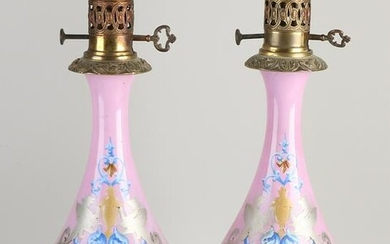 Two 19th century porcelain kerosene lamps with brass