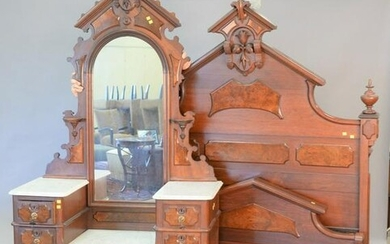 Two-piece walnut Victorian bedroom set with dropwell