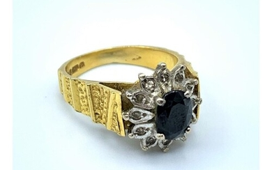 18ct yellow Gold Ring with grooved shoulders and claw set bl...