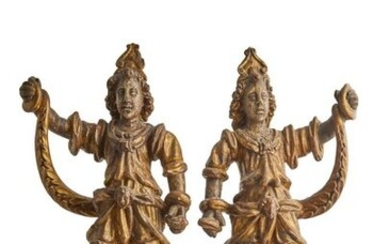 400-Pair of stuccoed and gilded wood carvings representing fancy characters...