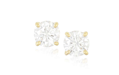 Description A PAIR OF DIAMOND EARSTUDS Each round brilliant-cut...