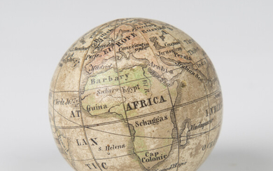 A 19th century pocket globe, formed from twelve printed gores, diameter 4cm, together with an origin