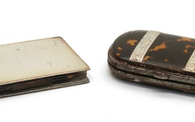 A 19th century silver and tortoiseshell purse of ovoid shape