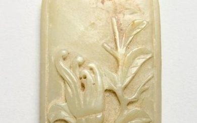 A CARVED JADE OBLONG PIECE.