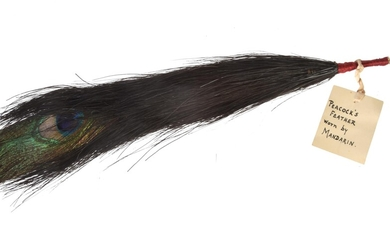 A Chinese 'One Eyed' peacock feather mandarin court hat plume