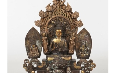 A Chinese bronze Buddhistic devotional group. Raised on a st...