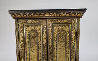 A Chinese lacquered wood dresser cabinet