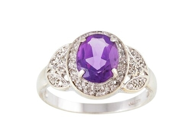 A DIAMOND AND AMETHYST CLUSTER RING, mounted in 9ct gold. Es...
