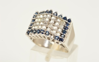 A DIAMOND AND SAPPHIRE RING, a tiered rectangular panel set ...