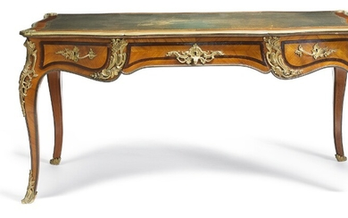 A French Rococo style rosewood and bronze mounted bureau plat, the top inset with green gilt tooled leather. 19th century. H. 74 cm. L. 174 cm. W. 80 cm.