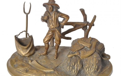 A French gilt bronze encrier modelled with a harvester