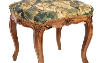 A French provincial walnut stool, circa 1750, the tapestry...