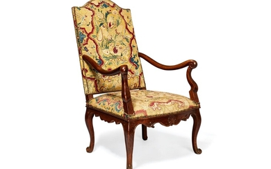 A French walnut and tapestry upholstered open armchair in Louis XV style